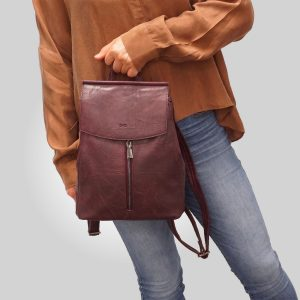 Convertible backpack in tan, brown, charcoal and black. Model Chloe | Boutique Kozy