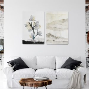 Mural in a living room with black and gold tree.