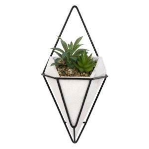 White ceramic wall planter with black geometric outline and artificial plants.